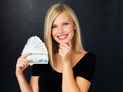 Woman holding EuroMillions winnings